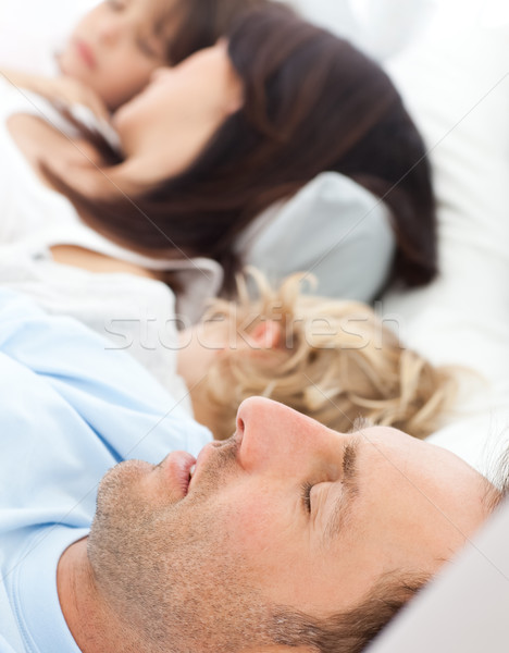 Serene family sleeping together in the morning in the parents's bed Stock photo © wavebreak_media