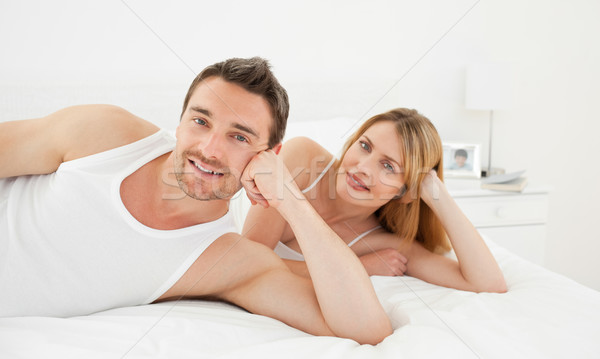 Happy lovers looking at the camera at home Stock photo © wavebreak_media