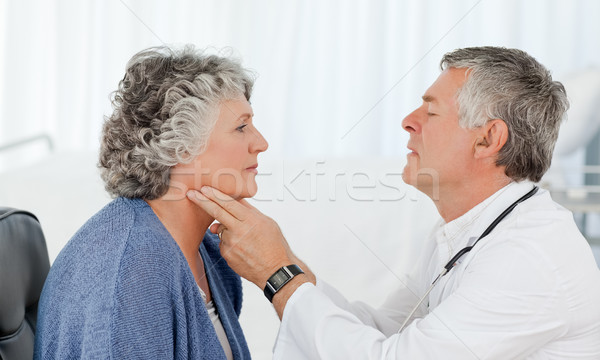 A senior doctor doing an examination of his patient Stock photo © wavebreak_media