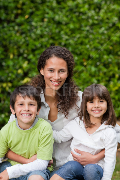 Mother with their children looking at the camera in the garden Stock photo © wavebreak_media