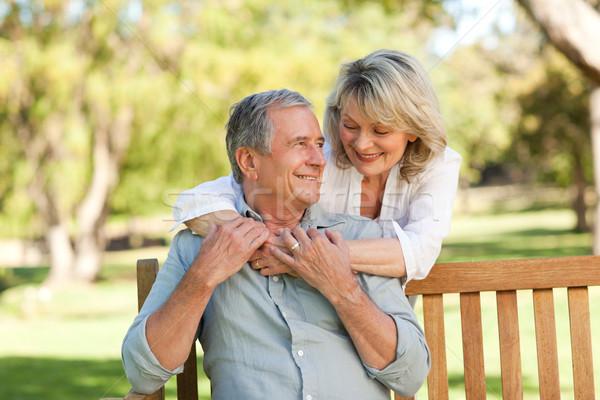 Senior woman hugging her husband who is on the bench Stock photo © wavebreak_media