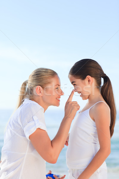 Mother applying sun cream on her daughter Stock photo © wavebreak_media