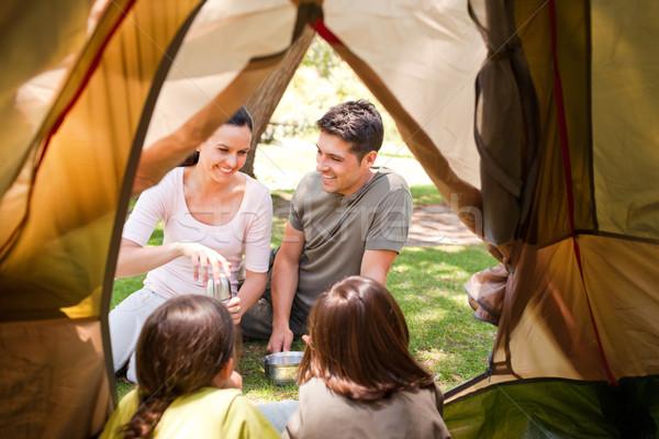 Happy family camping in the park Stock photo © wavebreak_media