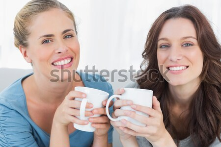 Colagem mulheres jovens potável bebida quente branco sorrir Foto stock © wavebreak_media