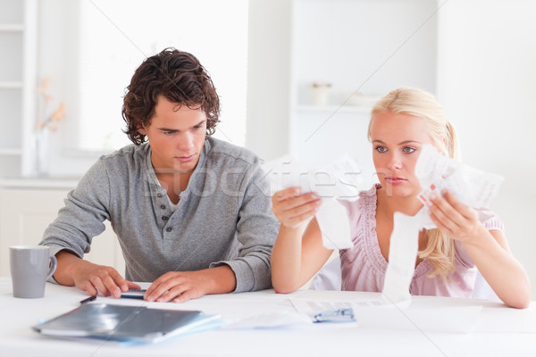 Couple in despaira doing their accounts in a living room Stock photo © wavebreak_media