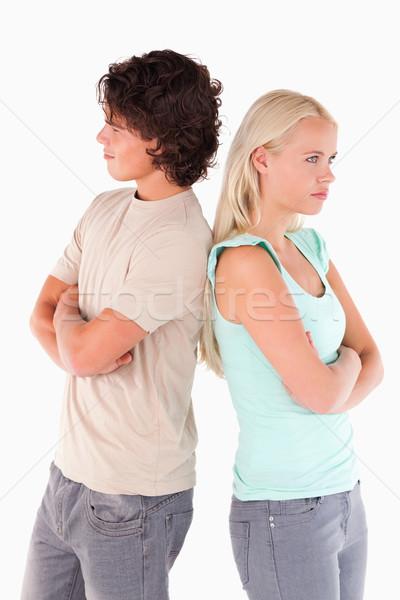 Stock photo: Unhappy couple posing in a studio