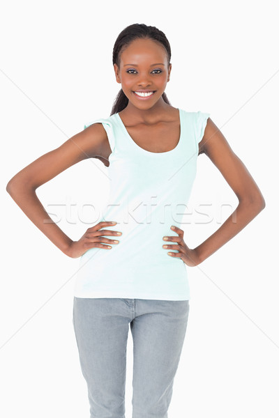 Close up of smiling woman with arms akimbo on white background Stock photo © wavebreak_media