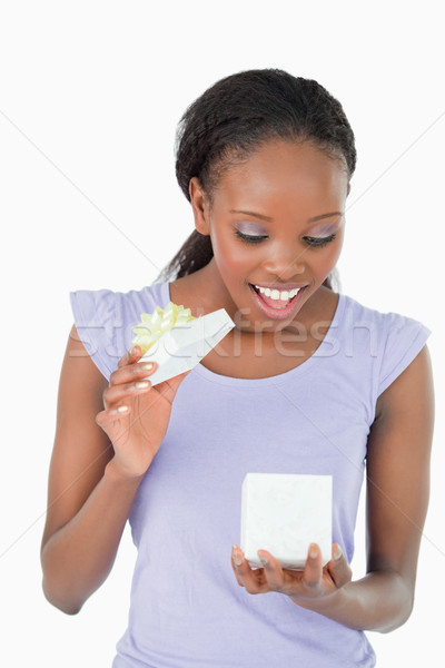 Close up of smiling woman being happy about a present against a white background Stock photo © wavebreak_media