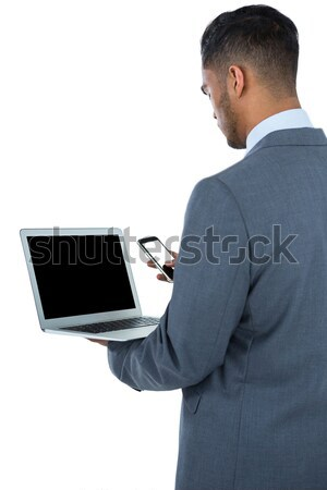 Young businessman showing whats on his screen against a white background Stock photo © wavebreak_media