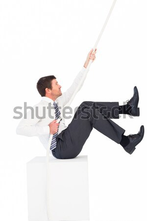 Businessman looking around the corner and is pointing against a white background Stock photo © wavebreak_media