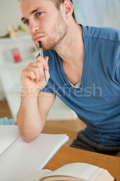 Young male student doing his homework Stock photo © wavebreak_media