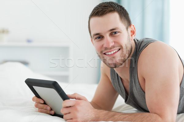 счастливым человека живота спальня лице Сток-фото © wavebreak_media