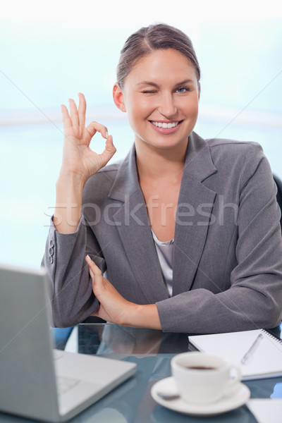 Portrait of a young businesswoman signing that everything is okay with a knowing smile Stock photo © wavebreak_media