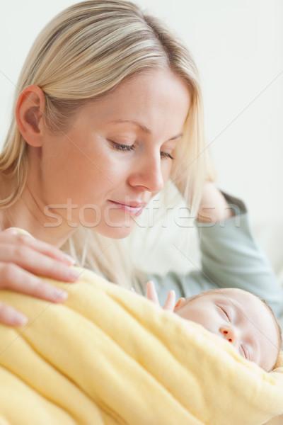 Young mother resting next to her sleeping baby Stock photo © wavebreak_media