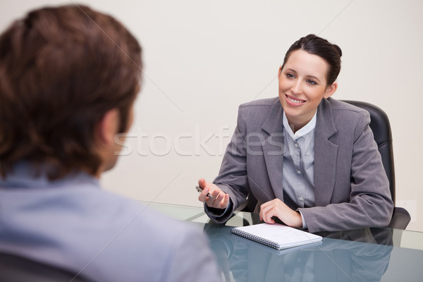 Smiling young businesswoman in a negotiation Stock photo © wavebreak_media