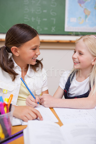 Portrait of happy pupils working together on an assignment in a classroom Stock photo © wavebreak_media