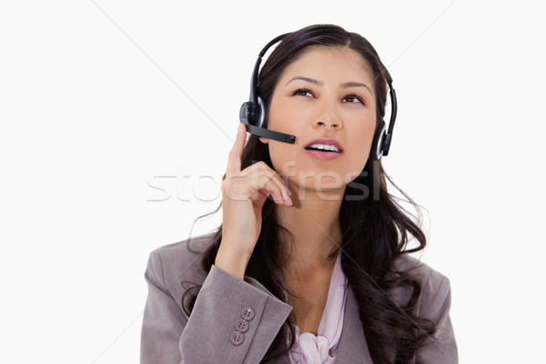 Businesswoman listening to caller with headset against a white background Stock photo © wavebreak_media