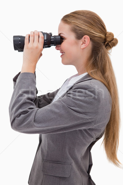 Side view of smiling bank employee with spyglasses against a white background Stock photo © wavebreak_media