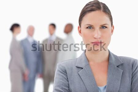 Grave imprenditrice colleghi dietro bianco business Foto d'archivio © wavebreak_media