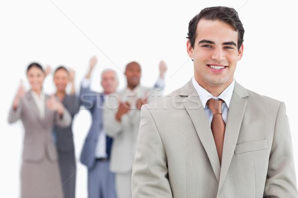 Sorridere venditore squadra dietro bianco Foto d'archivio © wavebreak_media