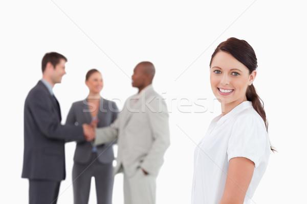 Mosolyog elarusítónő három kollégák mögött fehér Stock fotó © wavebreak_media