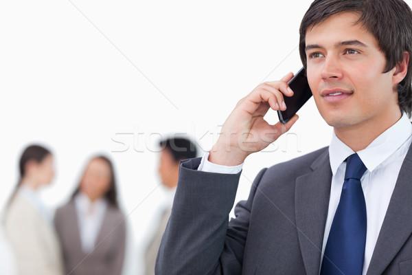 Vendedor celular equipe atrás branco mulher Foto stock © wavebreak_media