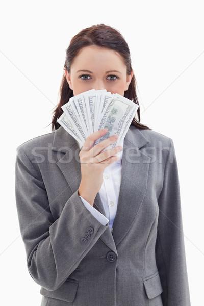 Közelkép üzletasszony rejtőzködik mögött dollár bank Stock fotó © wavebreak_media