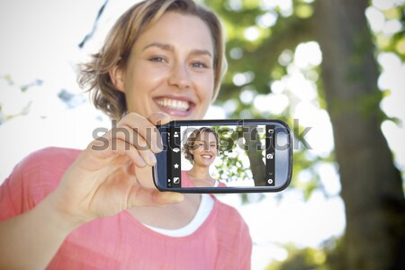 Digital camera held by a teenager photographing three friends with focus on the camera Stock photo © wavebreak_media
