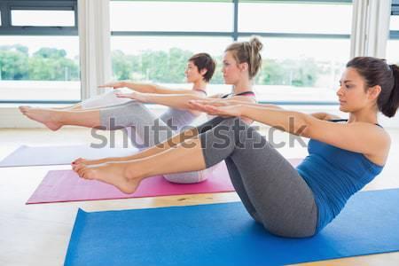 Photo stock: Femmes · yoga · classe · bateau · posent · fitness