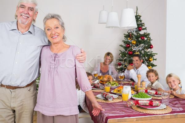 Grandparents standing by the dinner table Stock photo © wavebreak_media