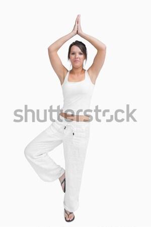 Portrait of woman in sportswear doing the tree pose Stock photo © wavebreak_media