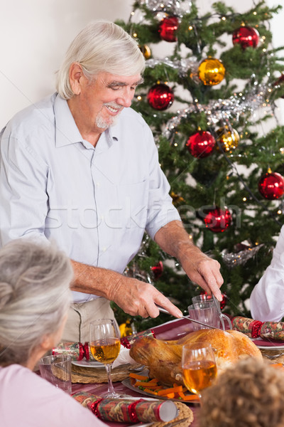 Grandfather carving turkey at christmas Stock photo © wavebreak_media
