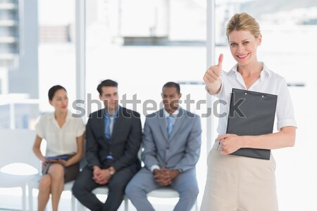 Businesswoman smiling and three business people speaking Stock photo © wavebreak_media