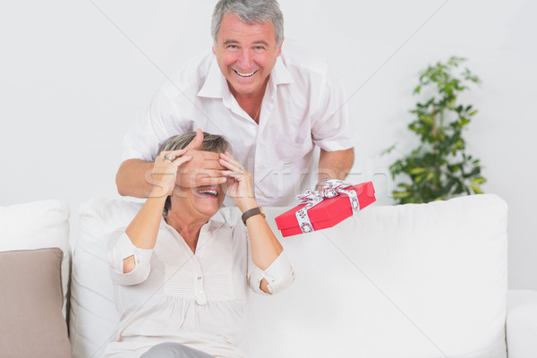 Old man hiding eyes of his wife for a gift Stock photo © wavebreak_media