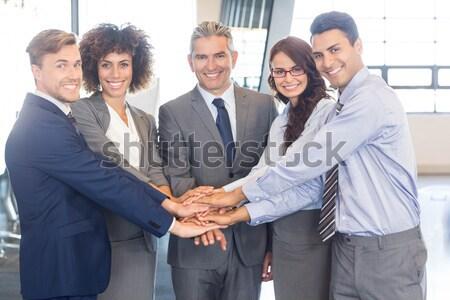 Csoport üzletemberek felfelé kezek együtt munkahely Stock fotó © wavebreak_media