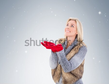 Composite image of sexy santa girl presenting with hand Stock photo © wavebreak_media