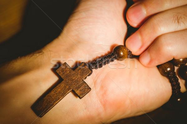 Mano rosario cuentas Foto stock © wavebreak_media