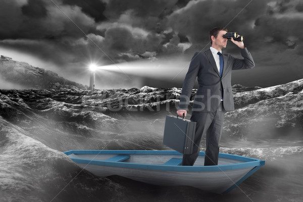 Stock photo: Composite image of businessman in boat with binoculars