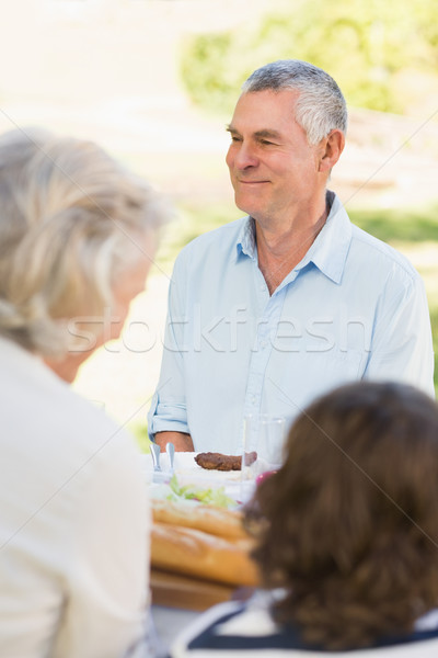 Senior man with family at outdoor dining table Stock photo © wavebreak_media