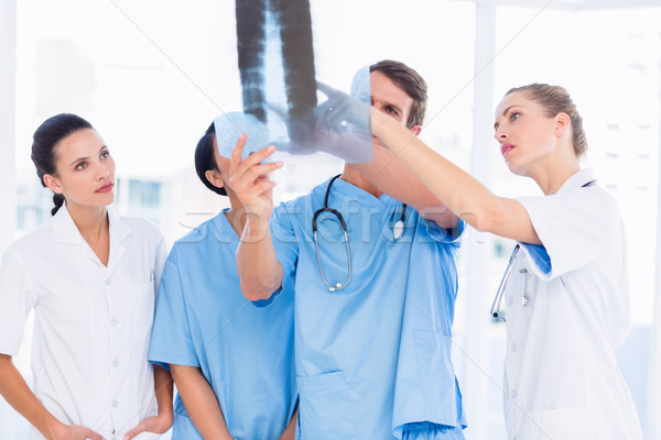 Group of doctors and surgeons examining xray Stock photo © wavebreak_media