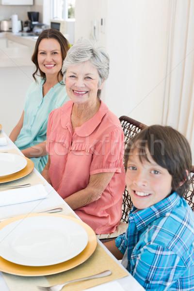 Multigeneration family sitting at dining table Stock photo © wavebreak_media