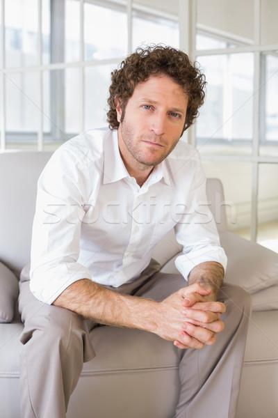 Portré jólöltözött fiatalember otthon nyugodt ül Stock fotó © wavebreak_media