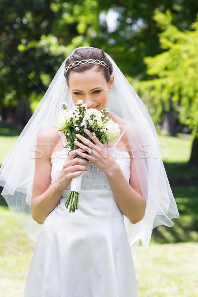 Bride smelling fresh flowers in garden Stock photo © wavebreak_media