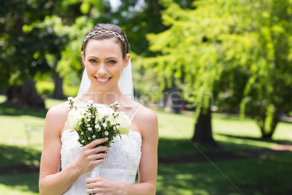 Attractive bride holding flower bouquet in garden Stock photo © wavebreak_media