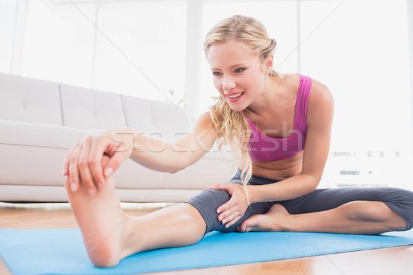 Toned blonde stretching on exercise mat  Stock photo © wavebreak_media