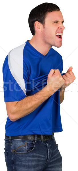 Excitado fútbol ventilador azul blanco hombre Foto stock © wavebreak_media