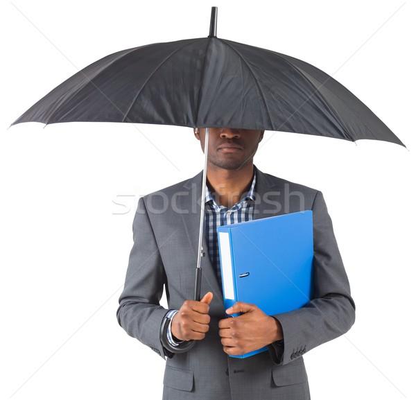 Empresario pie paraguas blanco carpeta masculina Foto stock © wavebreak_media
