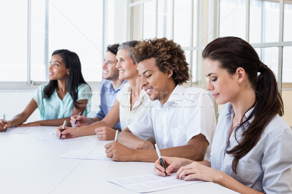 Casual business team taking notes in meeting Stock photo © wavebreak_media