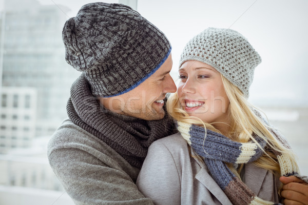 Cute couple in warm clothing smiling at each other Stock photo © wavebreak_media