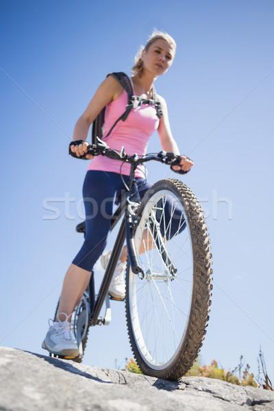 Fit pretty cyclist on a rocky terrain Stock photo © wavebreak_media